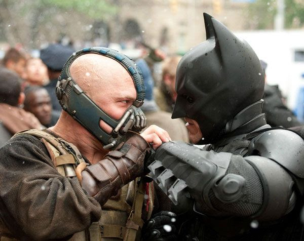 Bane and Batman duke it out in THE DARK KNIGHT RISES.
