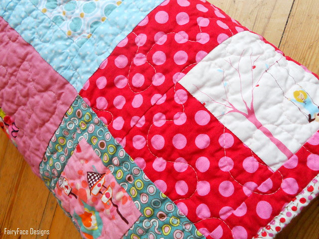 I Spy a Square Quilt rolled up