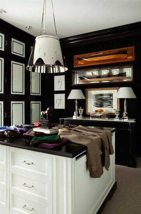 Walk-in closet with floor to ceiling glossy black & white cabinets, masculine