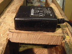 Fitting wooden casing for mains plug
