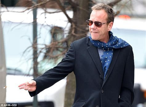 Kiefer Sutherland puffs away in New York after shooting 24
