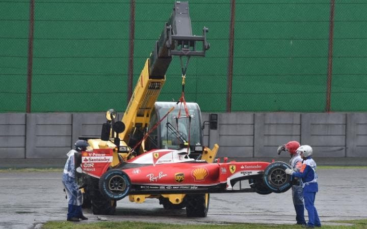 Kimi Raikkonen is removed from the track after he crashed and the race was stopped