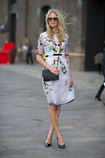 harpersbazaar:  Street Style: London Fashion Week Street Spring 2014 Photo credit: Diego Zuko  Loving this floral fresh spring outfit for SS 2014