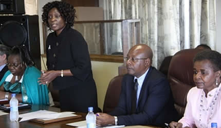 Zimbabwe Electoral Commission chairperson Justice Rita Makarau (standing), flanked by Commissioners Bessie Nhandara (left), Theophilus Gambe and her deputy Mrs Joyce Kazembe, speaks during a political parties' meeting in Harare on April 22, 2013. by Pan-African News Wire File Photos