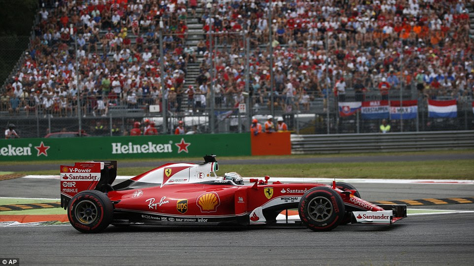 Ferrari's German driver Sebastian Vettel, who came home third, steers his car during the Italian Formula One Grand Prix