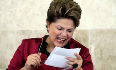 20141008053342_cv_Dilma-lendo_gde