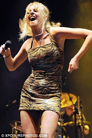 Energetic: Diana wore a tight printed dress as she performed an energetic dance routine on stage