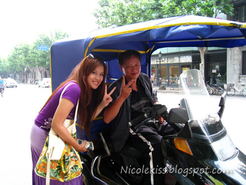 V pose with tuk tuk uncle