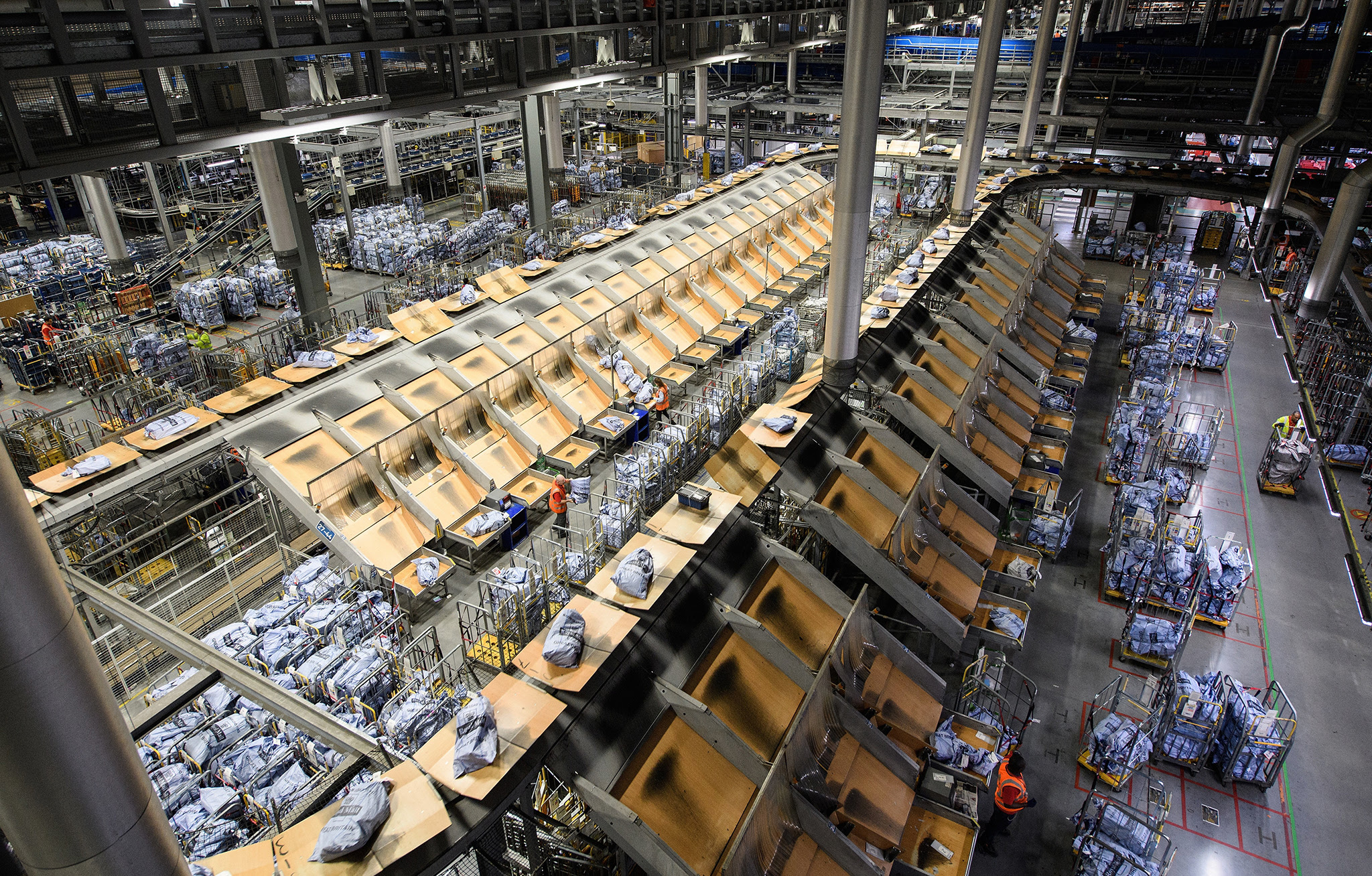 A general view of the conveyor belts and systems that handle the hundreds of thousands of items of mail that pass through the Royal Mail's Worldwide Distribution Centre on December 8, 2016 in Slough, England. The festive season sees a huge spike in postal items coming through the centre from all over the United Kingdom, destined for international destinations.  (Photo by Leon Neal/Getty Images)