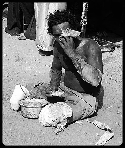 I cried because I had no shoes until I met a man who had no feet. by firoze shakir photographerno1