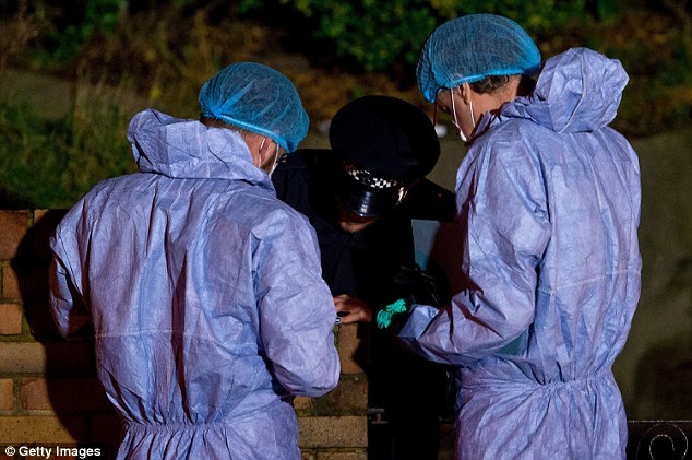 Inquiry: Police forensic officers could be seen working outside the family home this evening with a policeman