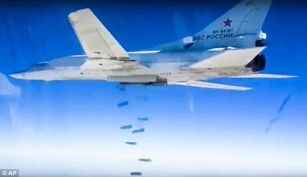 A Russian Tu-22M3 bomber drops bombs on a target in the latest round of air strikes in Syria
