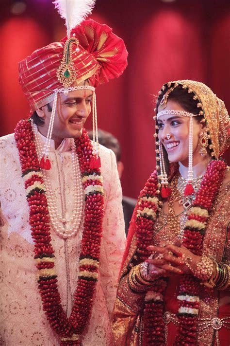 Ritesh Deshmukh & Genelia Desouza in their wedding dresses