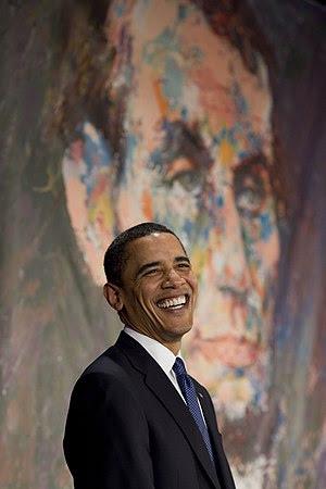 President Barack Obama in front of a portrait ...