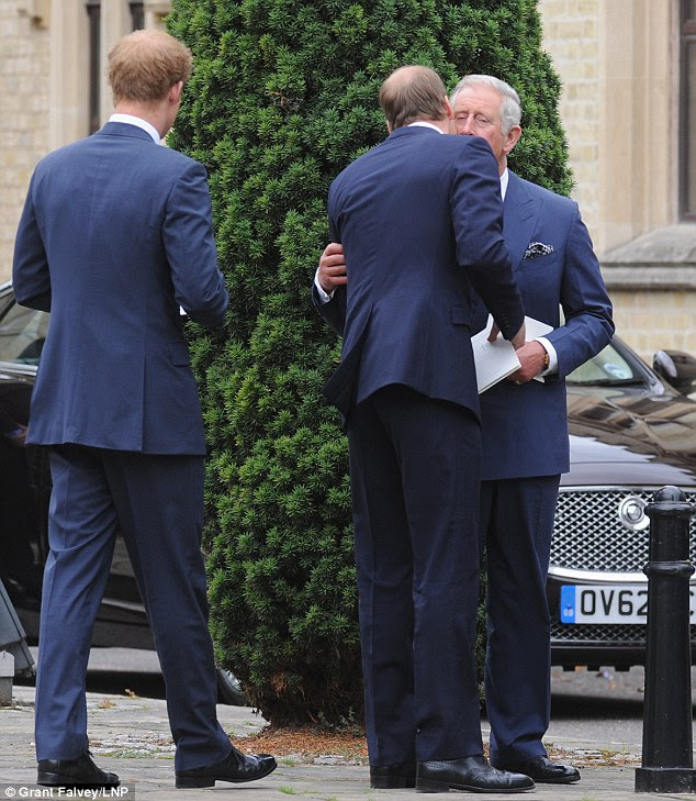 Goodbyes: The Prince looked emotional after the service as William and later Harry kissed him and left