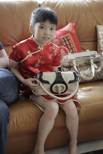 Arika with a Prada bag