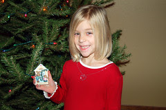 Sydney is into decorating the tree!