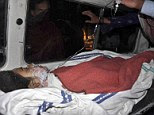 Tragedy: Pakistani teenager Aamna Bibi, seen here as she is taken to hospital on Thursday, has died from her injuries after setting herself on fire when police set free her alleged rapists