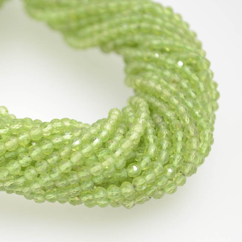 s40278 Stone Beads - 3 mm Faceted Rondelle Donuts - Peridot (strand)