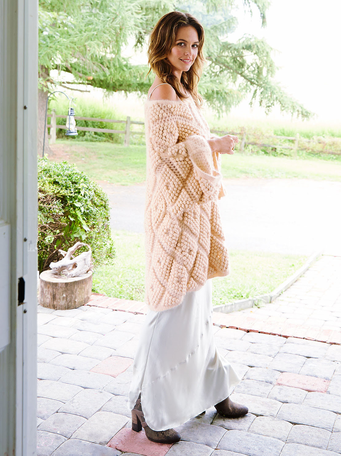 "Maran on her porch. <a href=""http://us.zimmermannwear.com/"">Zimmermann</a> sweater; Nili Lotan silk slip."