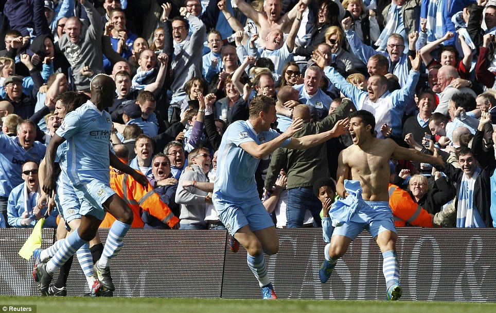 Amazing: Aguero is mobbed as the City fans struggle to believe what they are seeing