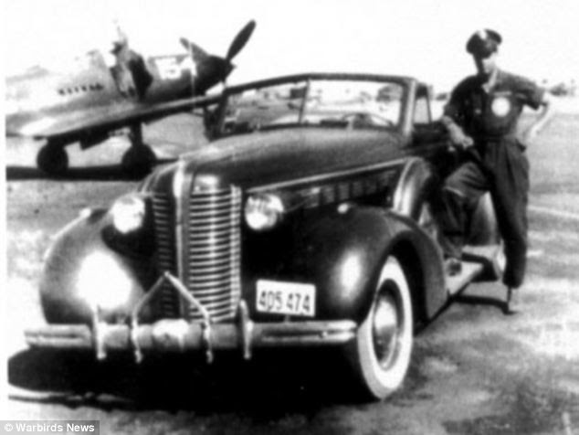 Proud: Overstreet is pictured in 1943 with his cherished 1938 Buick in California, where he trained