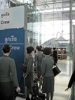 EVA air flight attendants at a aircrew counter of the Immigration Bureau at Suvarnabhumi International Airport - outbound