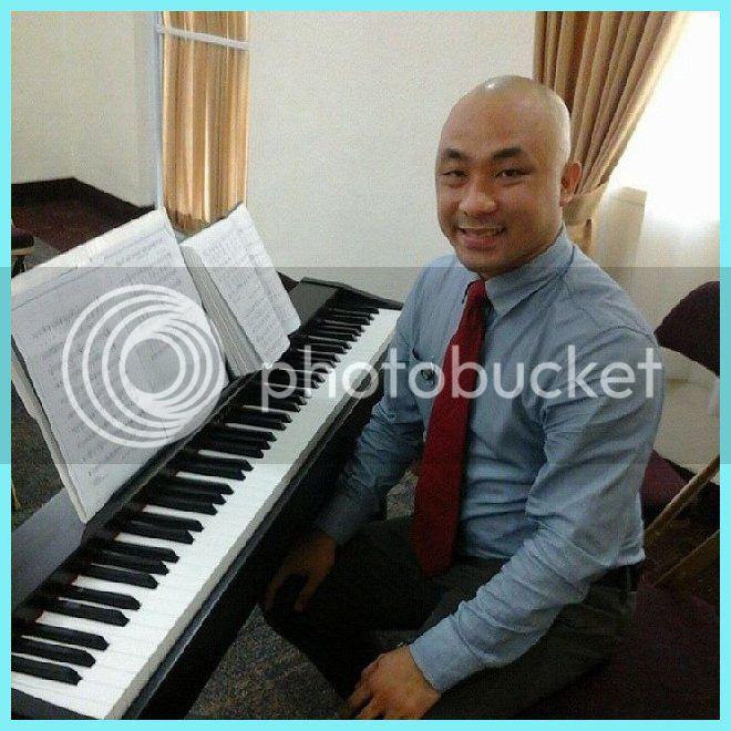 Music professor Alexander Magno on the keyboard.