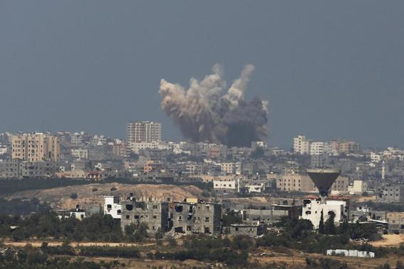 Smoke rises in the Gaza Strip after an Israeli strike August 8, 2014. REUTERS-Amir Cohen