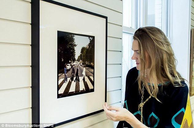 Sarah Wheeler, head of photography at Bloomsbury Auctions with one of the framed out takes from the famous Abbey Road photoshoot