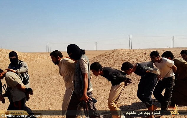 Ruthless: Bent double and barefooted, with their hands are bound behind their backs with rope, the prisoners are marched to the execution site in the desert near Deir ez Zor in Syra