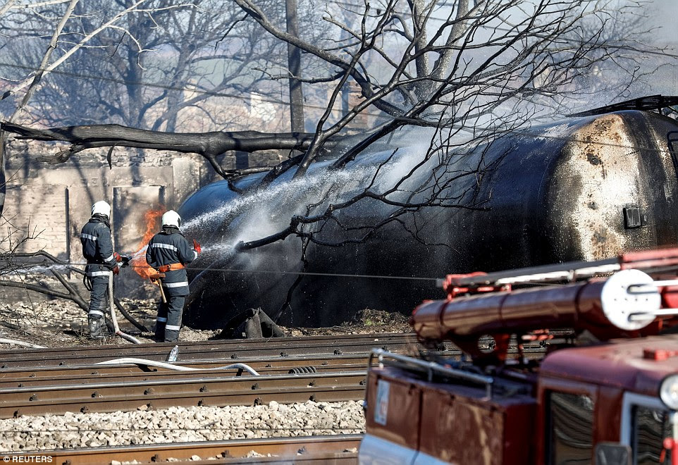 Charred tankers lay scattered around the tracks of the nearly ruined railway station as firefighters worked to put out the burning debris