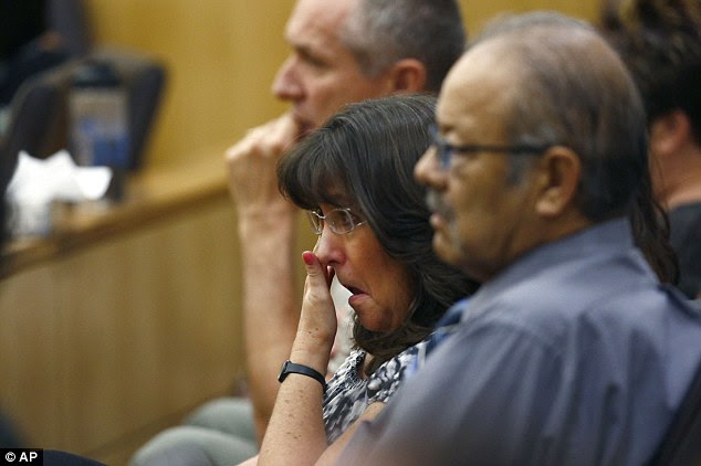 Heartbroken: Sandra Arias, mother of Jodi Arias, wipes tears away as her daughter addresses the jury