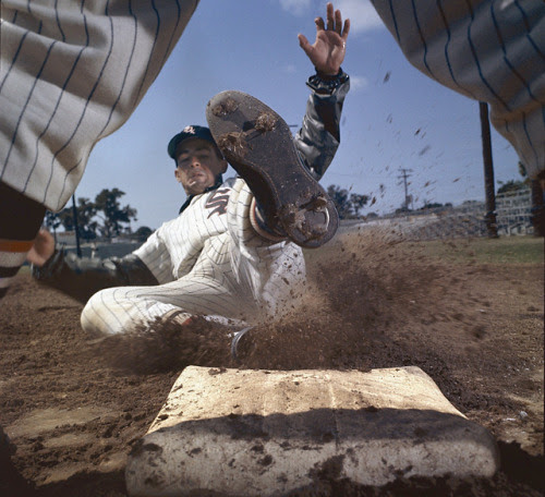 fuckyeahwhitesox:<br /><br />siphotos:<br /><br />White Sox shortstop Luis Aparicio slides into third base during a spring training photo shoot. This picture appeared on the cover of the April 30, 1962 issue of Sports Illustrated. (Mark Kauffman/SI)<br />SI VAULT: A group of colorful baseballers are keeping traditions alive (4.30.62)<br /><br />Not too much longer until baseball!<br />