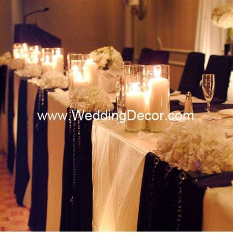 Wedding Decor Head Table   ivory linens, black runners