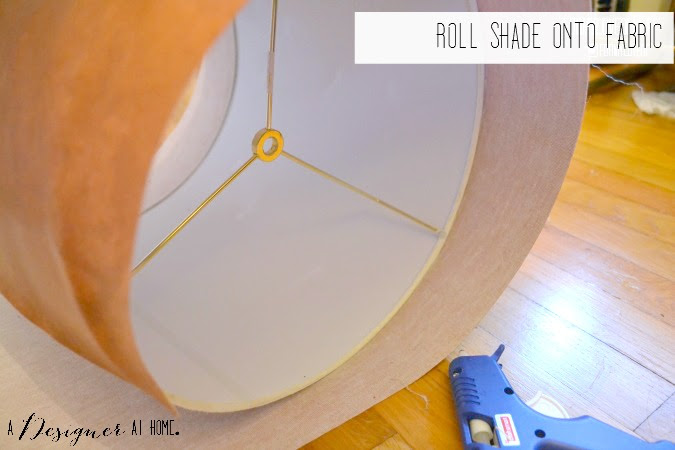 roll leather fabric onto shade using hot glue to secure in place