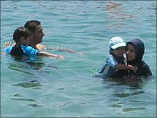 Muslim family in the sea