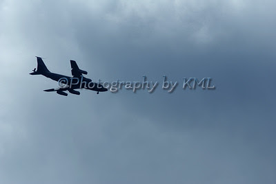 military refueling plane against dark clouds