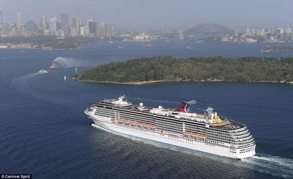 The Carnival Spirit, with 2500 passengers on board, is stranded outside of Sydney Harbour because of the city's wild weather