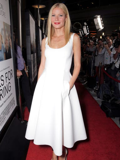Gwyneth Paltrow wows in white as she arrives on the red carpet at the Los Angeles premiere for her latest movie, 'Thanks for Sharing,' on Sept. 16. The movie will be in theaters Friday.