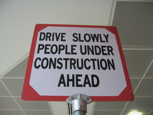 Drive Slowly - People Under Construction Ahead