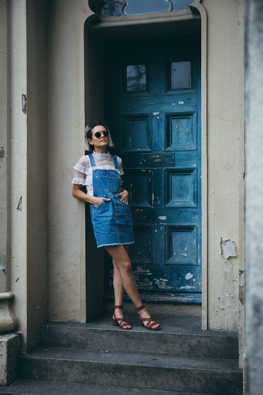 Le Fashion Blog Denim Overall Dress Girly Shirt Sandals Via Chloe Helen Miles