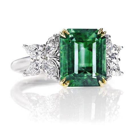 Harry Winston Marquesa Emerald Ring with diamonds. Octagon