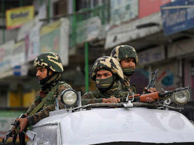 Security personnel patrol on the streets of Srinagar. (PTI photo)