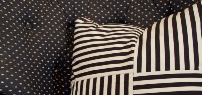 dash dot dotty dashdotdotty house tour interiors tan comfortable modern pattern mixing blue and white pillows rocking chair