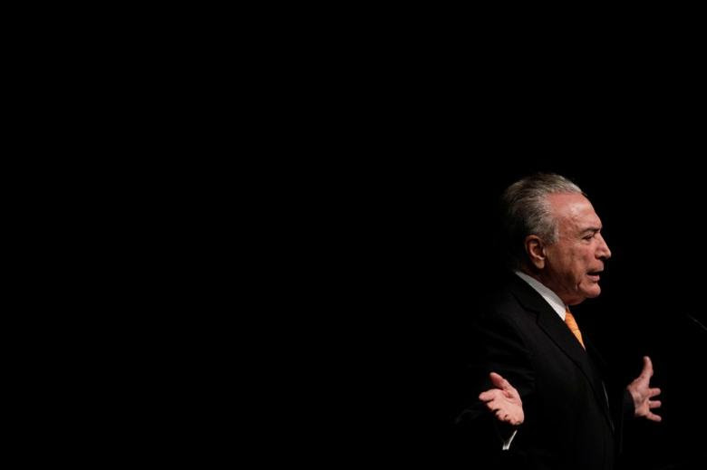 FILE PHOTO - Brazil's President Michel Temer gestures during opening ceremony of the 20th conference of the march in defense of the municipalities, in Brasilia, Brazil May 16, 2017. REUTERS/Ueslei Marcelino