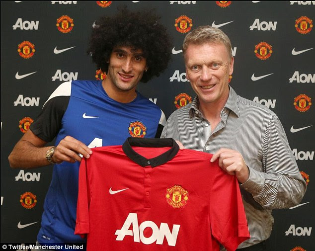 Done deal: David Moyes (right) finally sealed a move for Marouane Fellaini to join Manchester United