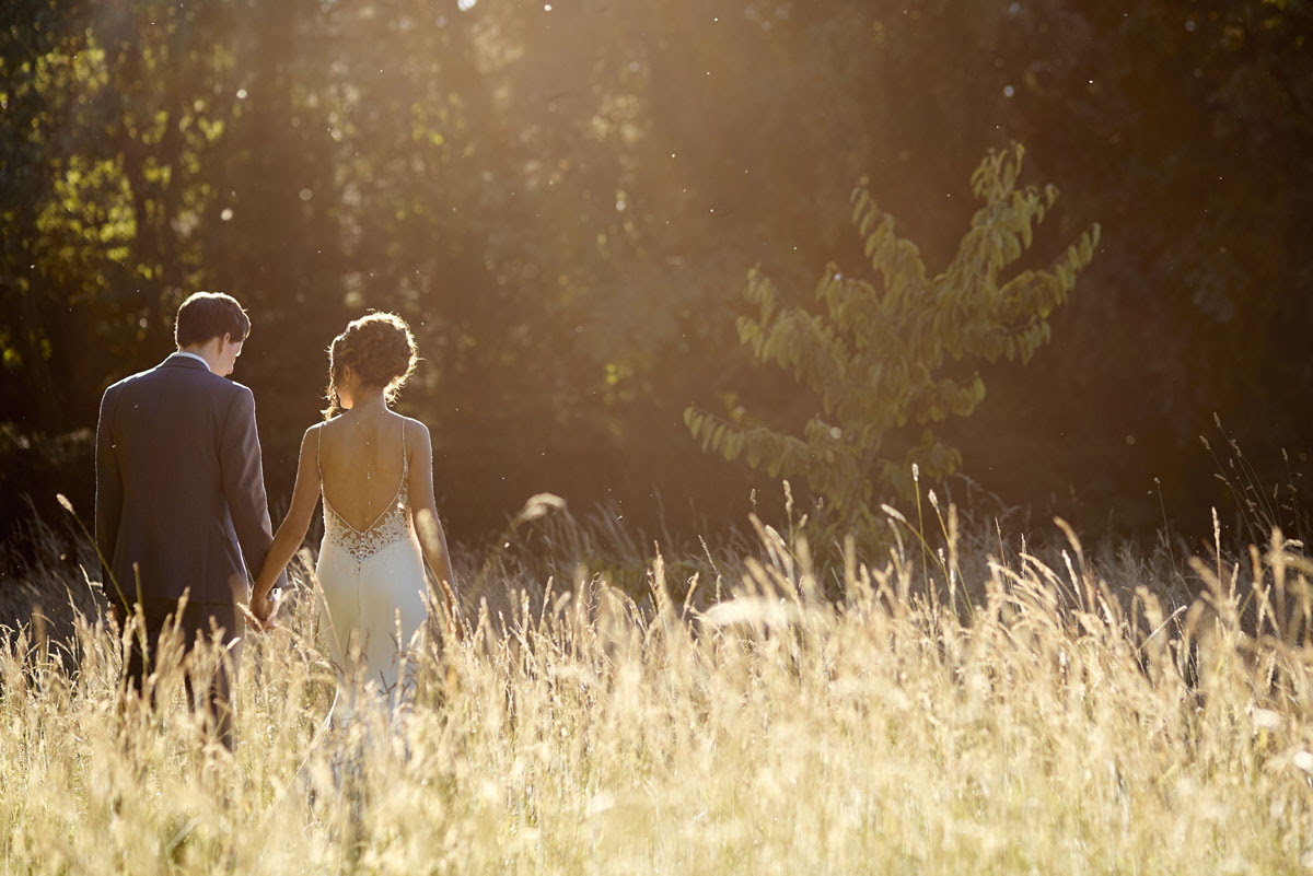 Bride and groom in evening sunlight at Lanwades Hall Wedding Photos - helloromancephotography.com