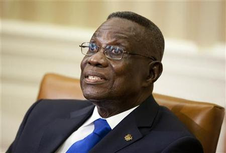 Ghana's President John Evans Atta Mills speaks during a meeting with U.S. President Barack Obama in the Oval Office of the White House in Washington March 8, 2012. REUTERS/Joshua Roberts