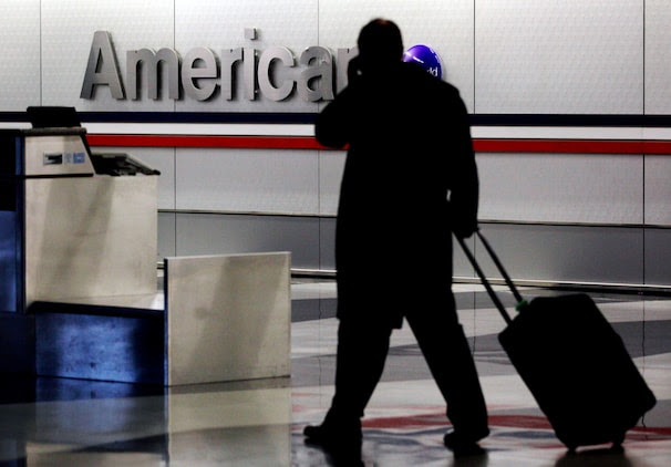A passenger walks through an American Airlines baggage claim area at O'Hare International Airport in Chicago. (Nam Y. Huh/ AP)